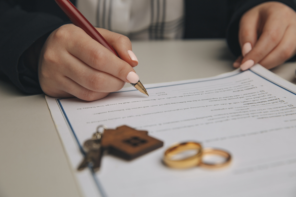 woman signing a divorce